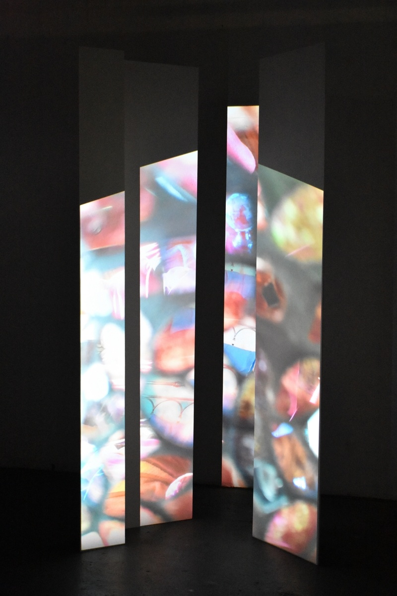 This is an art Portfolio by Priti Patel. The light installation is Fragmented and it  shows fragments of images that look like stained glass. The fragments are traumatic memories that emerge and disappear like glimmers of coloured lights. The full image shows but the memory is still fragmented. The fragments emerge to the rhythm of the song by First Aid Kit, You are the Problem Here.